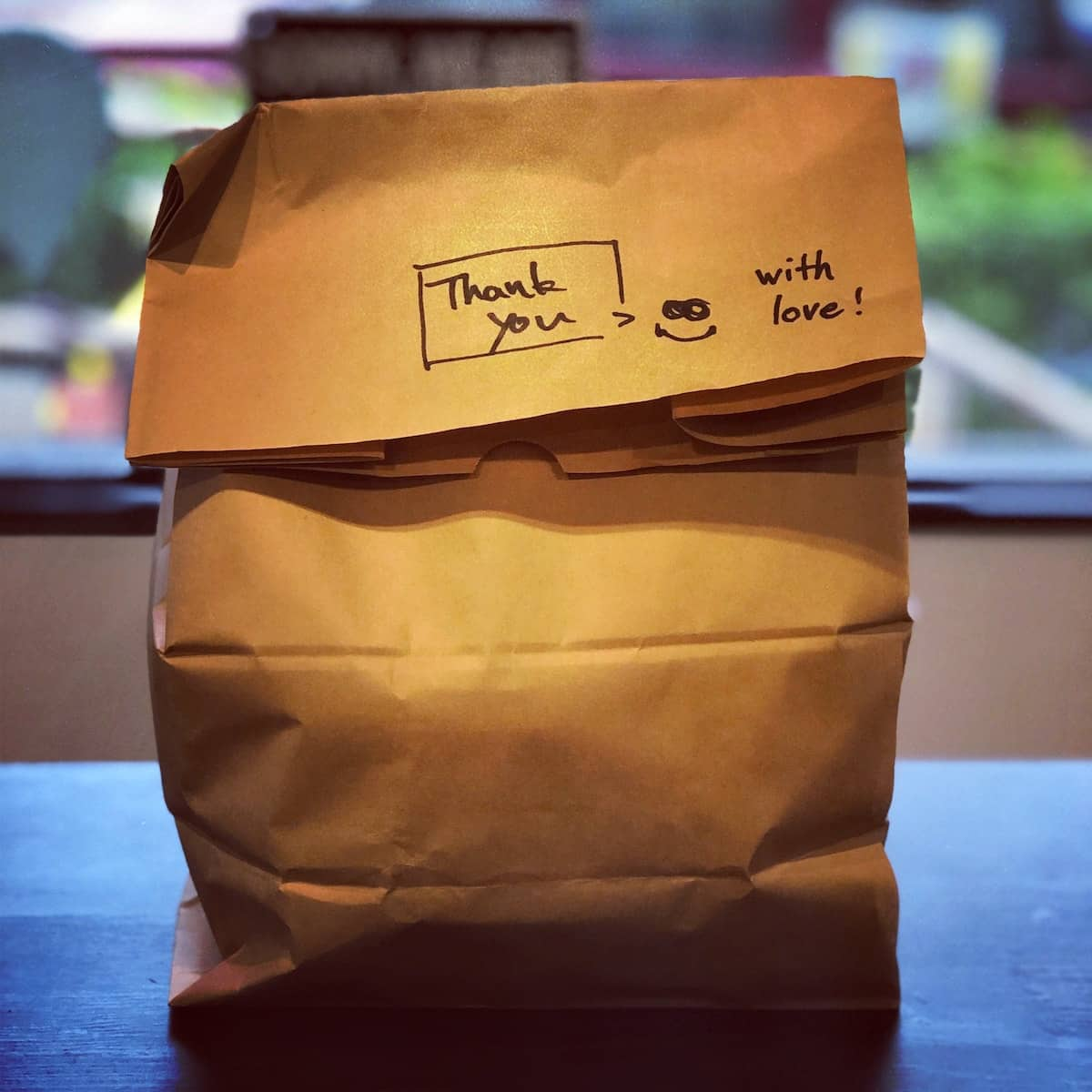 brown paper bag with note