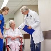 hospital hallway nurse doctor and elder patient
